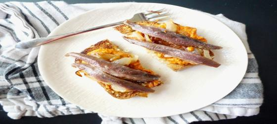 TAPAS Anchovy toasts with caramelized onions and pimientos recipe
