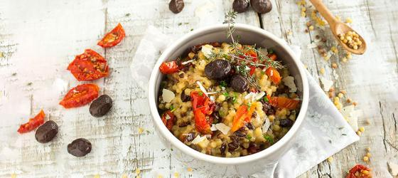 Fregola sarda risotto with black olives and tomatoes recipe